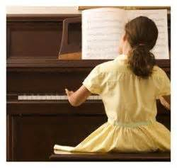 child with hobby playing piano